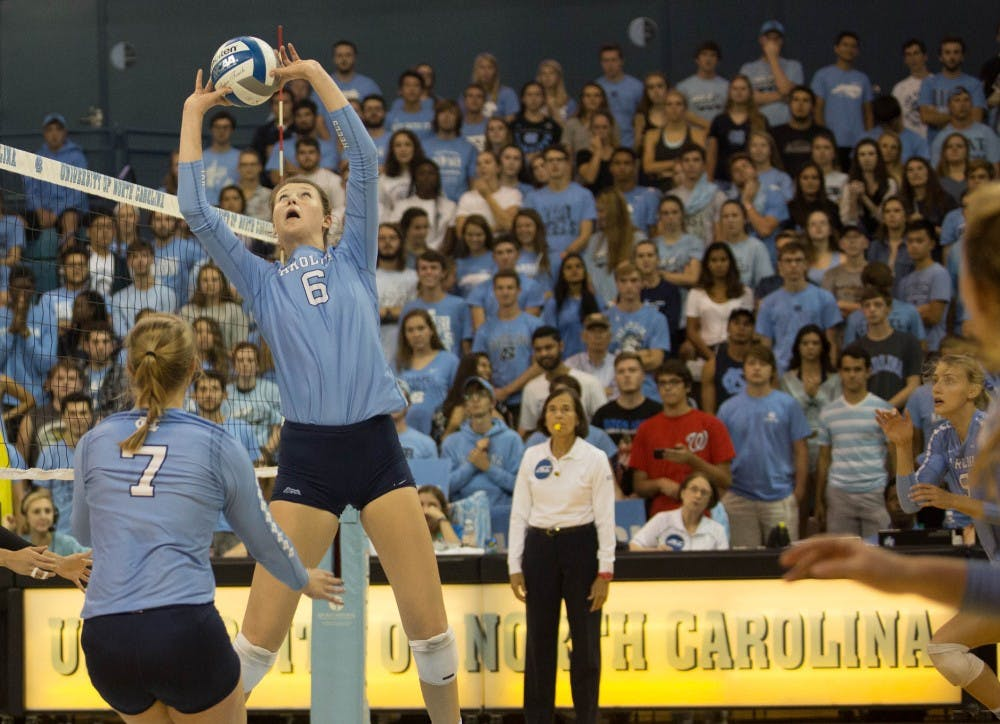 Carlton's triple-double leads UNC volleyball over Duke in four sets
