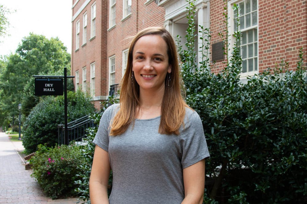 Anna Hamilton, a current PhD student in the department of American studies and the host of the Southern Oral History Workshop, poses outside of Dey Hall. Prior to her time at UNC, Hamilton received her undergraduate degree from the New College of Florida and a masters from the University of Mississippi.