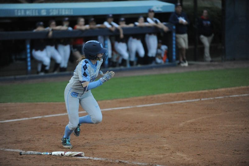 Senior Destiny DeBerry, number 22, runs for first base after hitting the ball at the UNC softball match against Liberty University on Wednesday, April 10, 2019 at the Anderson Softball Stadium. UNC won 3-2.