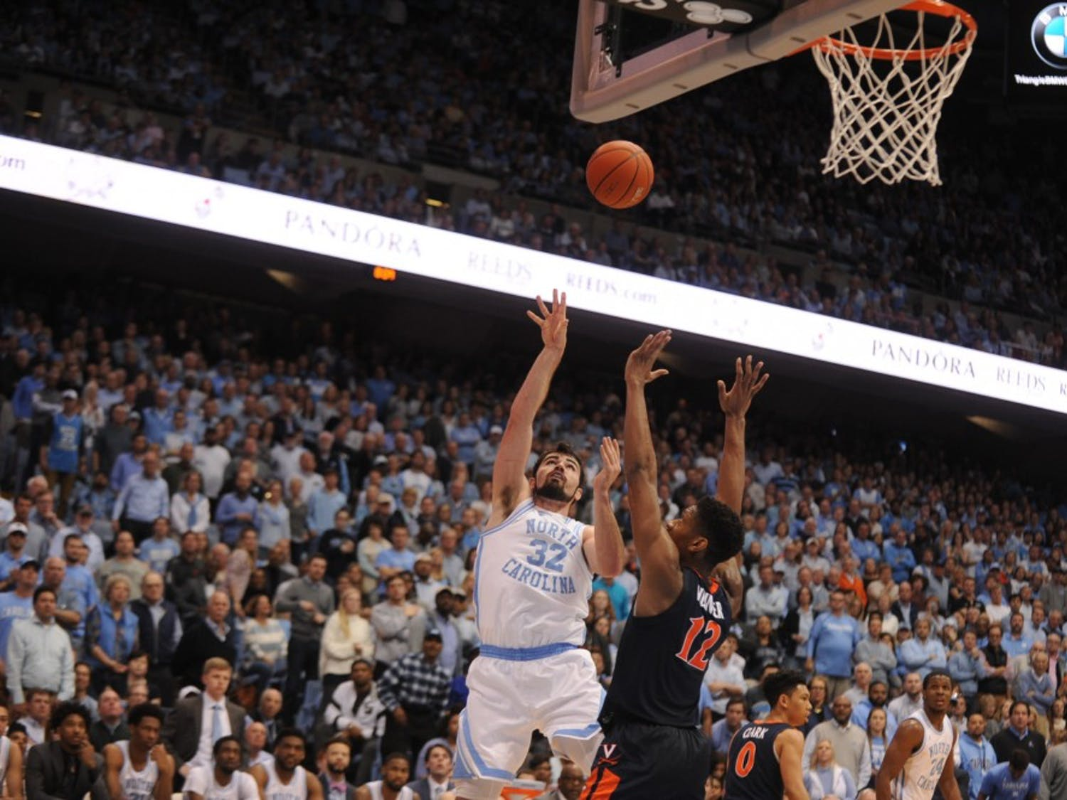 Virgina redshirt sophomore guard De'Andre Hunter (12) guards UNC senior forward Luke Maye (32) as he attempts to score on Monday, Feb. 11, 2019 in the Smith Center. UNC lost 61-69.
