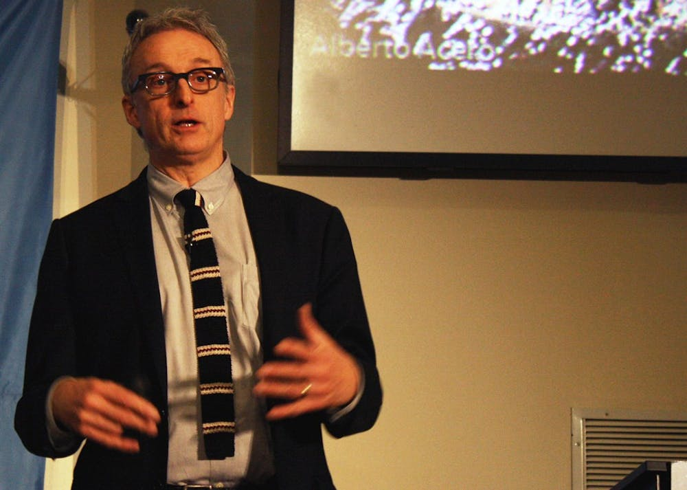 """David Kirkpatrick, bestselling author of """"The Facebook Effect,"""" gives his lecture on """"Ten Lessons From Facebook"""" as a part of the Roy H. Park Distinguished Lecture Series. Kirkpatrick discussed how Facebook has come to be one of the most powerful and influential companies in the world. With over 750 million active users, Kirkpatrick said, Facebook can be used to unite people and spread information in ways never before possible.The slide in this picture is of a 2008 revolution in Bogota, Columbia that began as a Facebook event. The event was created on a whim by a Colombian man who was frustrated with the government; one month later, thousands of people gathered to protest."""
