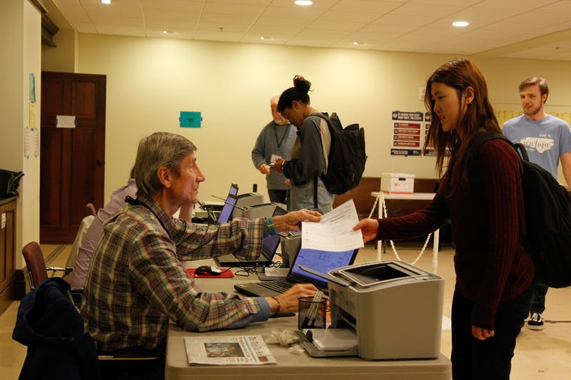 Volunteers at the Chapel of the Cross assist voters with registration for the upcoming primary election on Wednesday, Feb. 26, 2020.