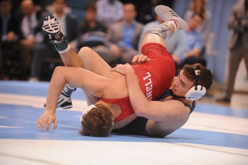 UNC sophomore Josh McClure takes down Cornell junior Adam Santoro. No. 9 Cornell defeated UNC 29-5 on Saturday, Feb. 17, 2019 in the Carmichael Arena.