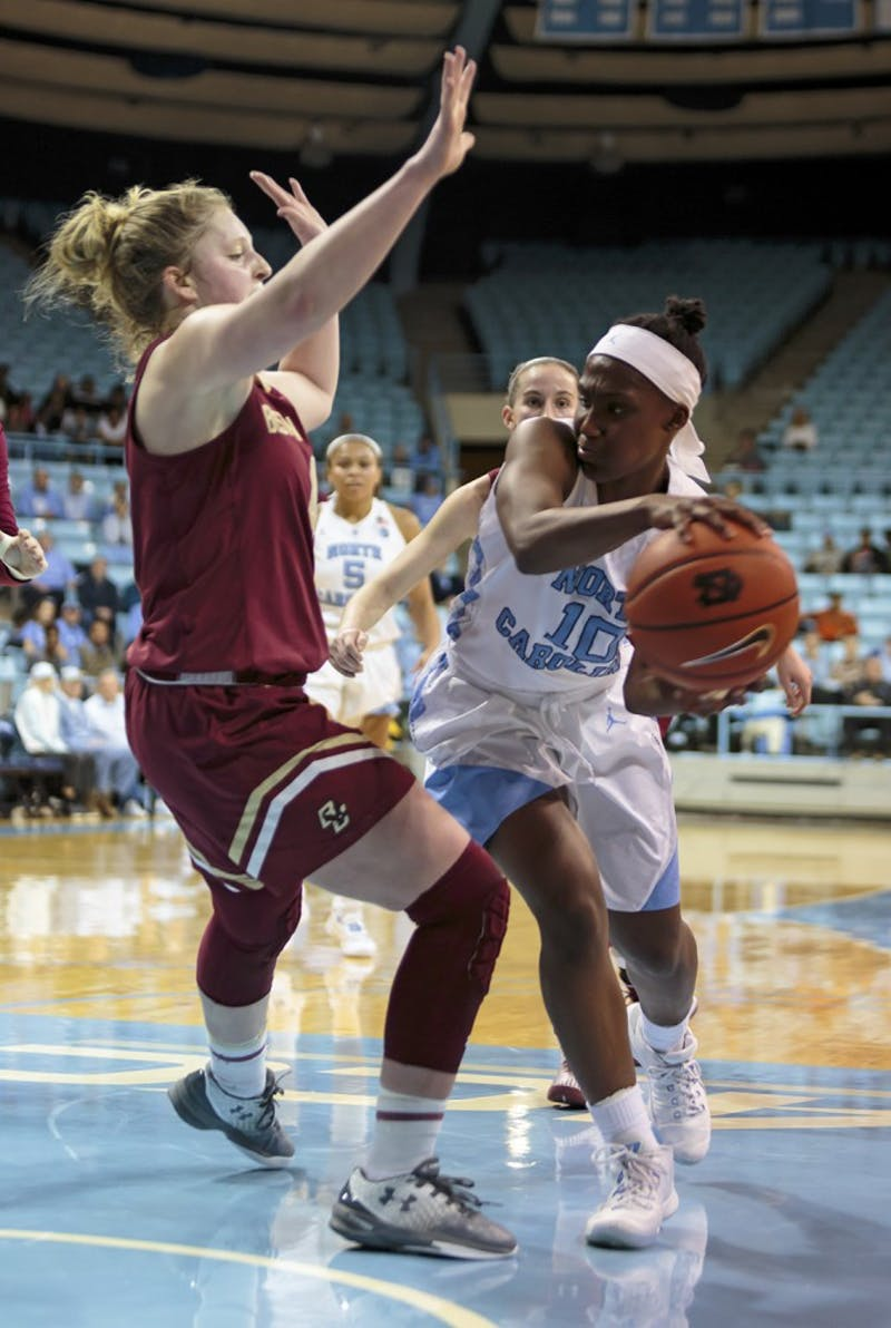 North Carolina guard Jamie Cherry (10) looks to pass the ball around a Boston College defender Thursday night.
