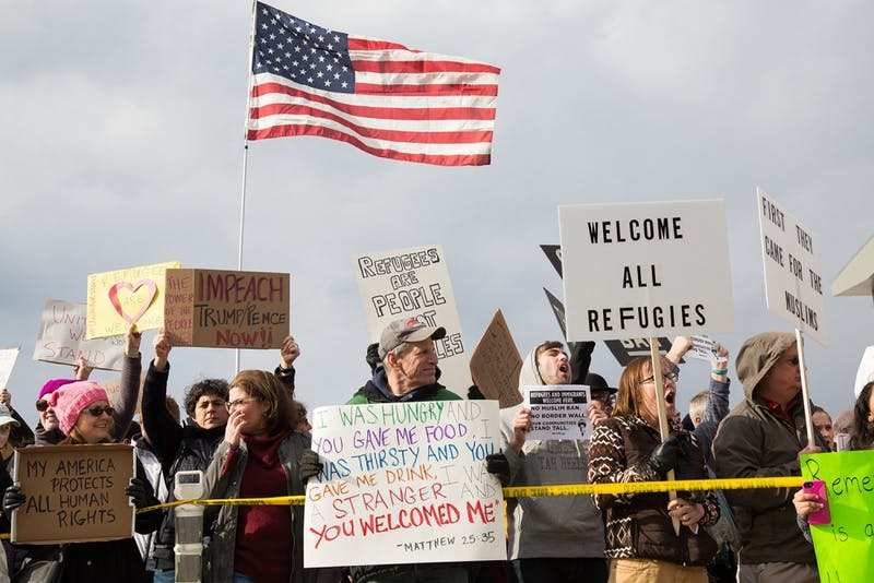 Protesters gather outside terminal two at RDU Airport on Jan. 29 in response to President Donald Trump's executive order banning immigrants from certain countries from entering the U.S.