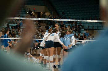 Junior Aristea Tontai convenes with her teammates after giving a point during UNC Volleyball's 3-0 win over Duke on thursday.