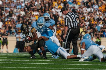 Appalachian State wide receiver Malik Williams (14) is taken down by UNC players in Kenan Memorial Stadium on Saturday, Sept. 21, 2019. UNC lost to Appalachian State 34-31.