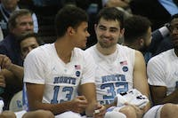 UNC players Luke Maye (32) and Cameron Johnson (13) smile after another turnover against Tennessee Tech on November 16th in the Dean Dome.