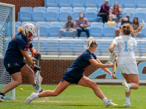 UNC first year attacker Caitlyn Wurzburger (13) hits the ball right through the goalies legs to score a goal at the game against Virginia on Sunday Apr. 18, 2021 at the Dorrance Field. UNC won 15-4.
