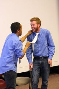 """Jordan Hale, Political Science and Communication Studies double major, and Kenan Bateman, Journalism and Mass Communication and Communication Studies double major, of the UNC comedy troupe False Profits rehearse Thursday evening in Hanes Arts Center for their debut show, """"Wanted,"""" on Sunday."""