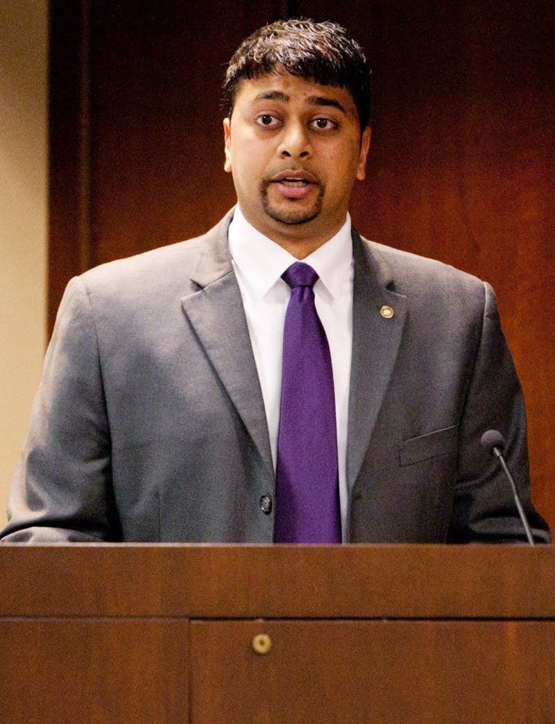 Atul Bhula makes a speech after being recognized during the Board of Governors meeting on Friday.