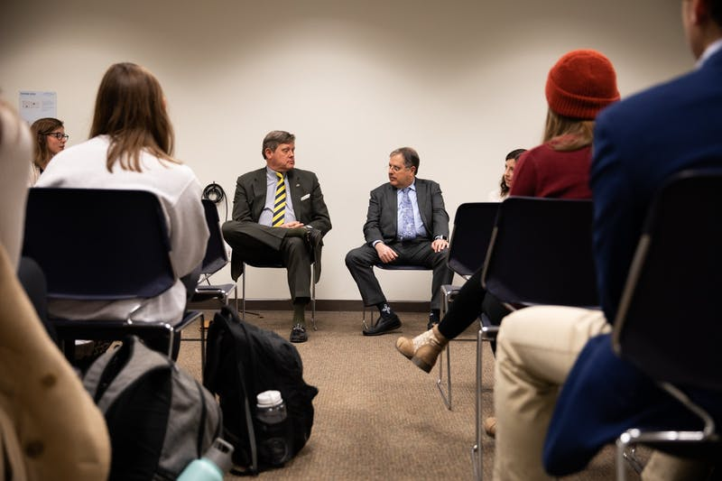 "N.C. Sen. Mike Woodard (left), D-Durham, and Harrison Kaplan, a lobbyist in the N.C. General Assembly, turn toward each other during the Lobbying 101 Workshop event hosted by the Undergraduate Executive Branch of the Student Government in the Student Union on Thursday, Nov. 14, 2019. ""I tell people: 'I'm a lobbyist. It's impossible to offend me,'"" Kaplan said, speaking on lobbying in legislature."
