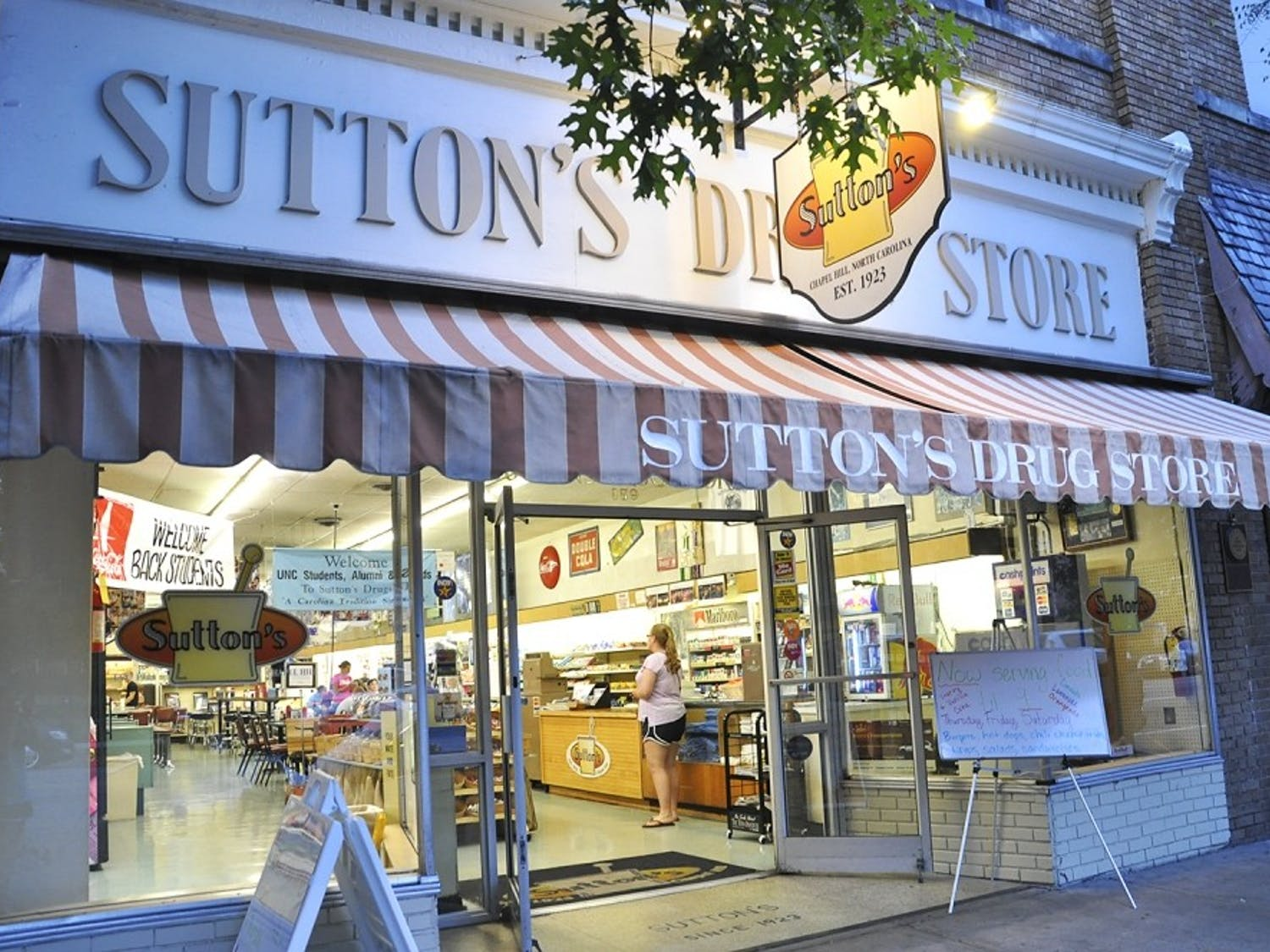 """Sutton's Drug Store displays pictures of students, athletes and community members from their unique collection of """"family photos."""""""