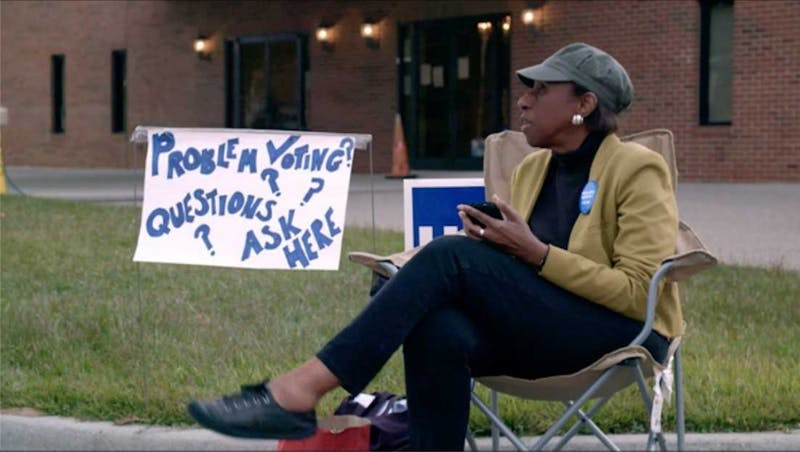 "Volunteer voter protection worker, Brooklyn -based entertainment lawyer, and producer of ""Capturing the Flag"" Laverne Berry sits outside a polling location. The documentary premiered in Durham at the Full Frame Documentary Film Festival. Photo courtesy of Nelson Walker III"