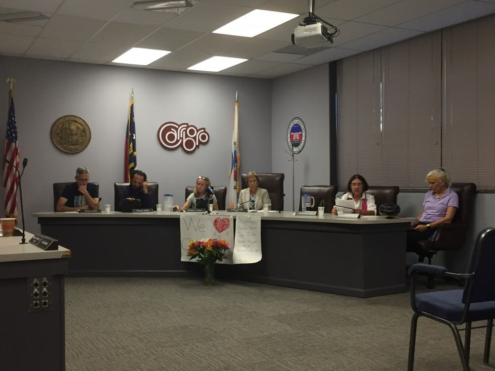 <p>Carrboro's Board of Aldermen met Wednesday to approve a resolution in solidarity with Charlottesville.</p>