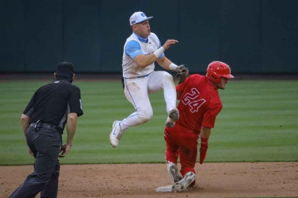 UNC sophomore Danny Serretti (1) leaps after throwing the ball during the Tar Heels' 1-6 loss against N.C. State on Saturday, March 27, 2021 in Boshamer Stadium in Chapel Hill, N.C.