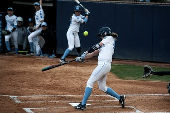UNC catcher/first baseman Megan Dray (55) hits a triple with bases loaded during the 4-1 win over Georgia Tech on Friday, March 22, 2019 in Anderson Stadium in Chapel Hill, N.C. The Tar Heels improved their record to 6-1 in ACC play.