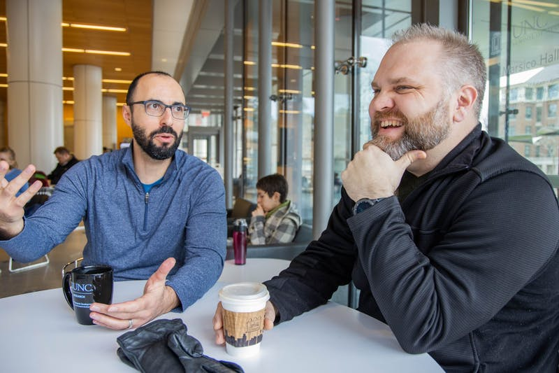 Todd Cohen (left) and Jonathan Schisler (right) share a laugh in Saladelia Cafe in Marsico Hall on Friday, Jan. 24, 2020. Cohen and Schisler work together to improve research on Alzheimer's disease.