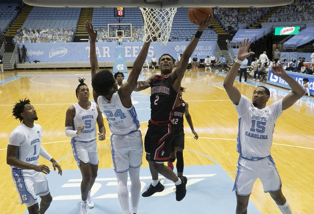Northeastern's Tyson Walker (2) drives to the basket for two of his game high 27 points during the second half against North Carolina on Wednesday, February 17, 2021 at the Smith Center in Chapel Hill, N.C. Photo courtesy of Robert Willett.