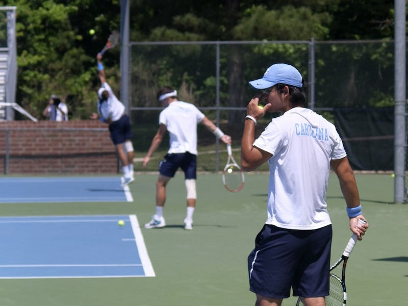 Jack Murray, Robert Kelly and Brayden Schnur each prepare to serve against William and Mary
