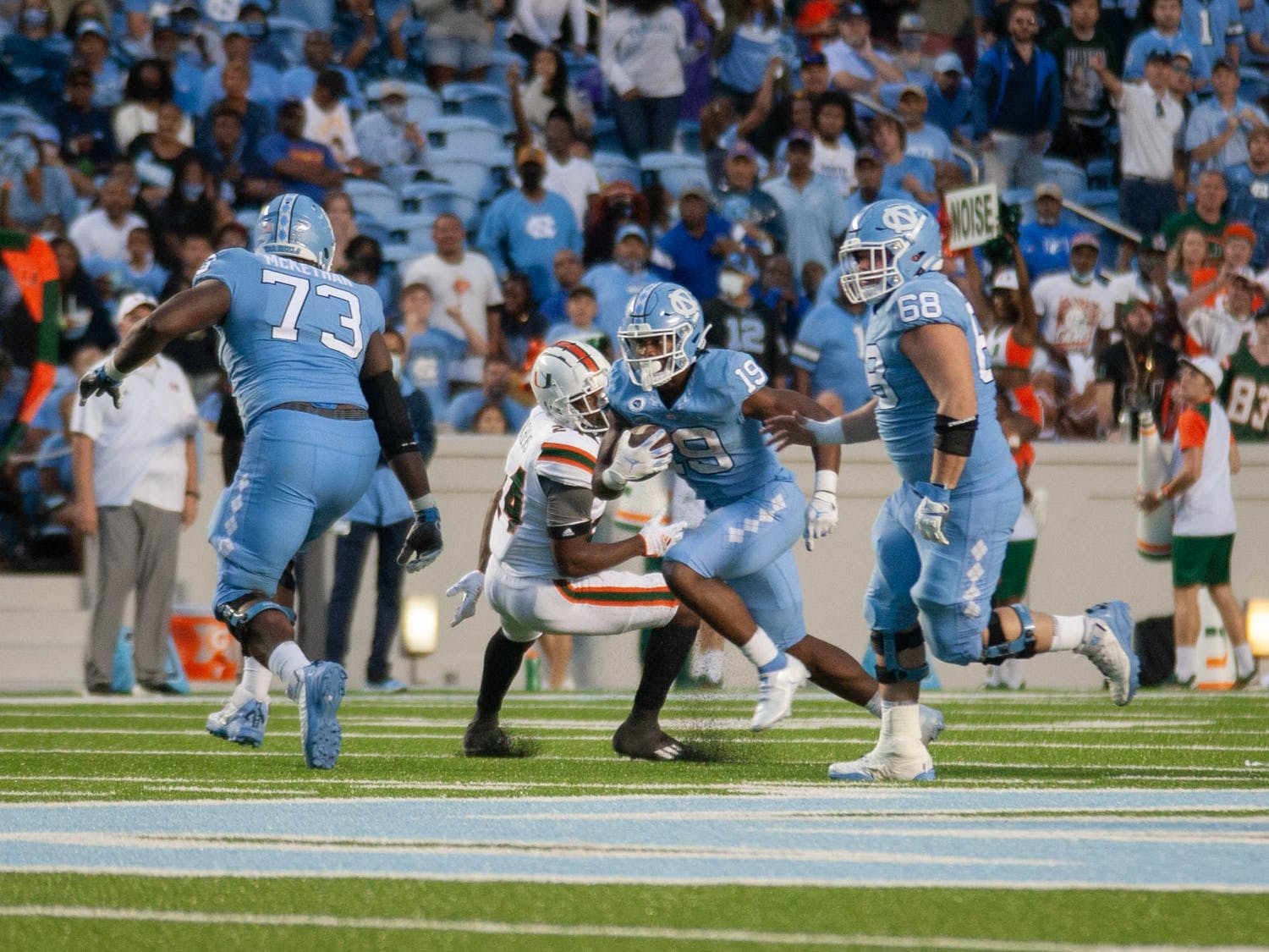Graduate Student rrunning back Ty Chandler (19) runs the ball during the Tar Heels' football game at Kenan Stadium on Oct. 16 againt Miami. UNC won 45-42.