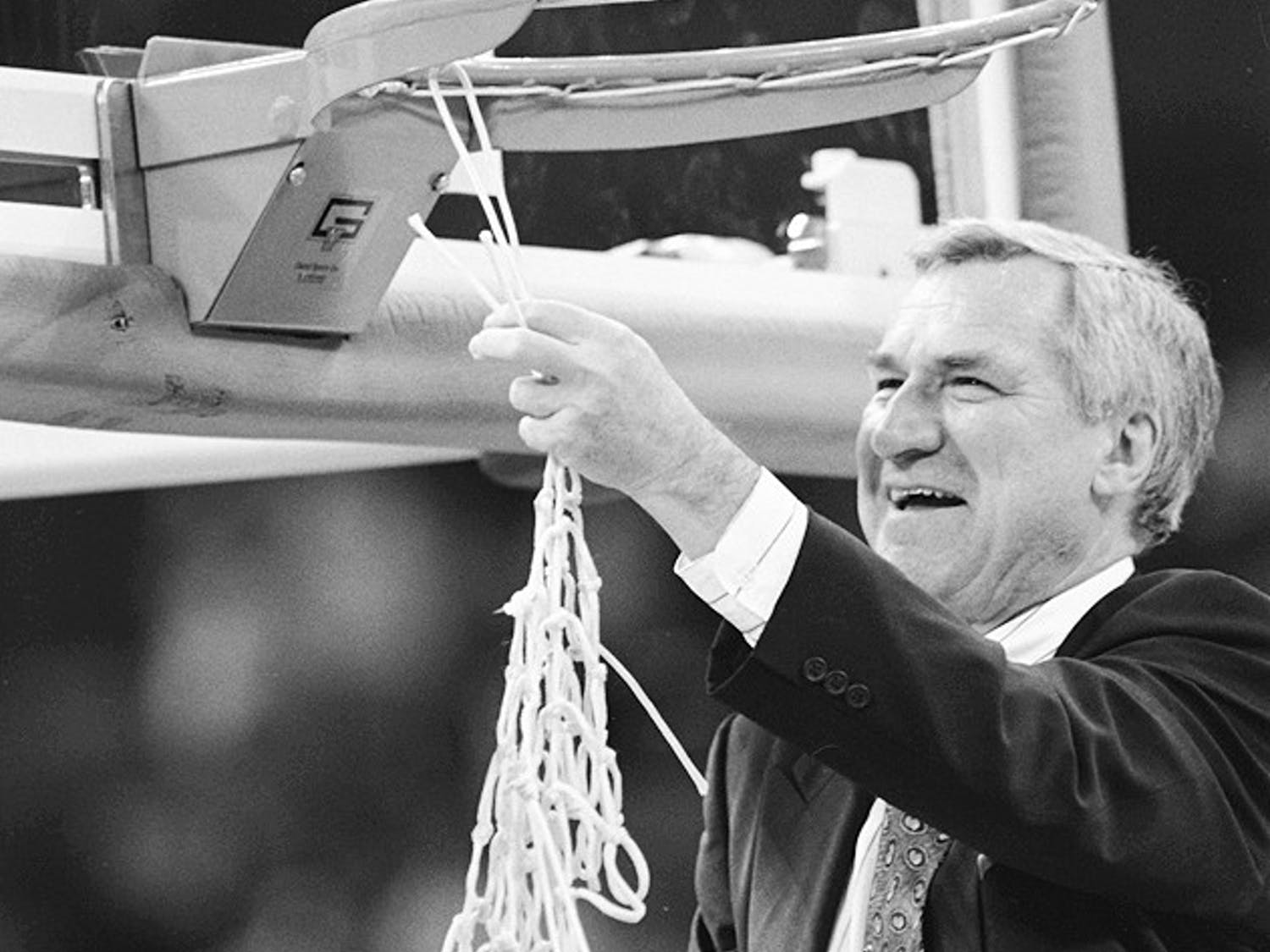 Previous Head Coach Dean Smith cuts down the net at the UNC vs. Michigan NCAA championship game in New Orleans, L.A. in 1993.   	Photo Courtesy of North Carolina Collection, UNC-CH