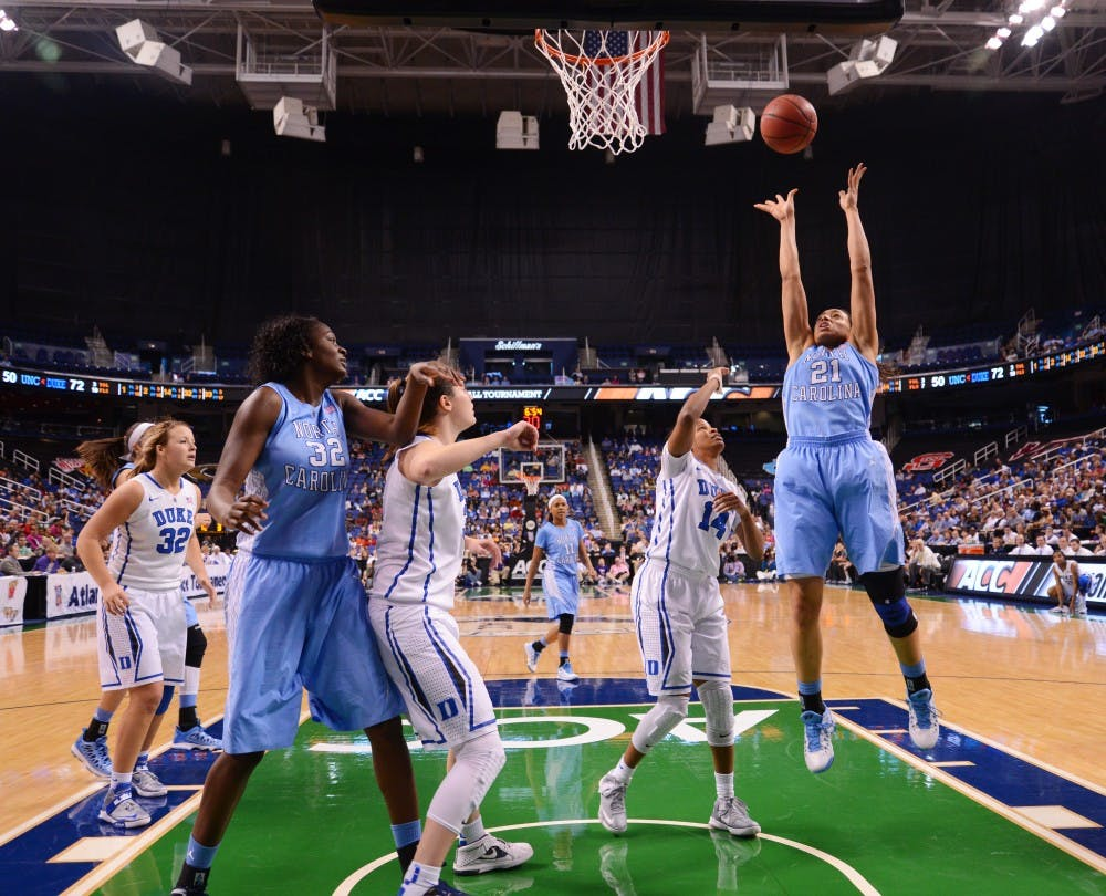 """<p>Krista Gross, 21, takes a shot against Duke in the <span class=""""caps"""">ACC</span> Tournament championship game. Gross scored eight points in UNC's 92-73 loss.</p>"""