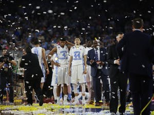 Justin Jackson (44) looks at the scoreboard as confetti falls after the national championship in 2016. The Tar Heels hope to take the title this year following the 77-74 loss to Villanova last year.