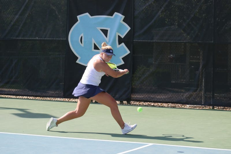 Alle Sanford hits a return against Virginia on April 13 at the Cone-Kenfield Tennis Center.
