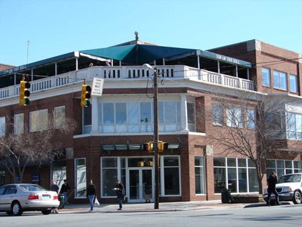 Top of the Hill opens new bar, hall