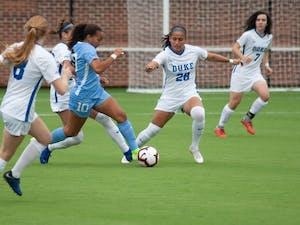 UNC women's soccer forward, Rachel Jones (10) dribbles past defenders during a game against Duke on Sunday August 25, 2019. UNC beat Duke 2-0.