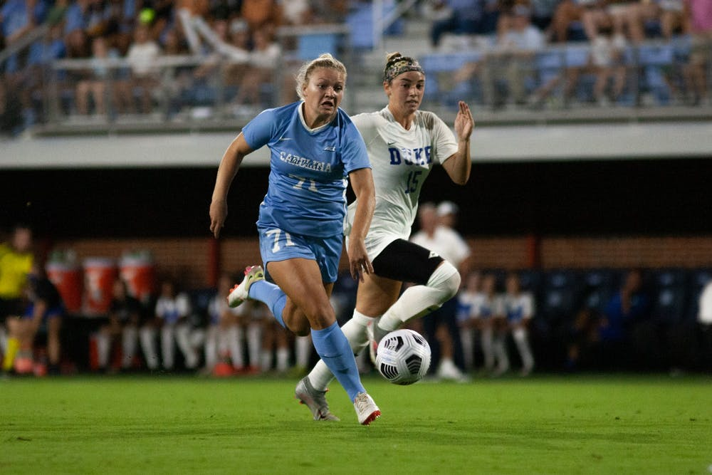 UNC sophomore forward Mollie Baker (71) runs with the ball at the game against Duke at Dorrance Field on Sept. 17. UNC lost 1-0.