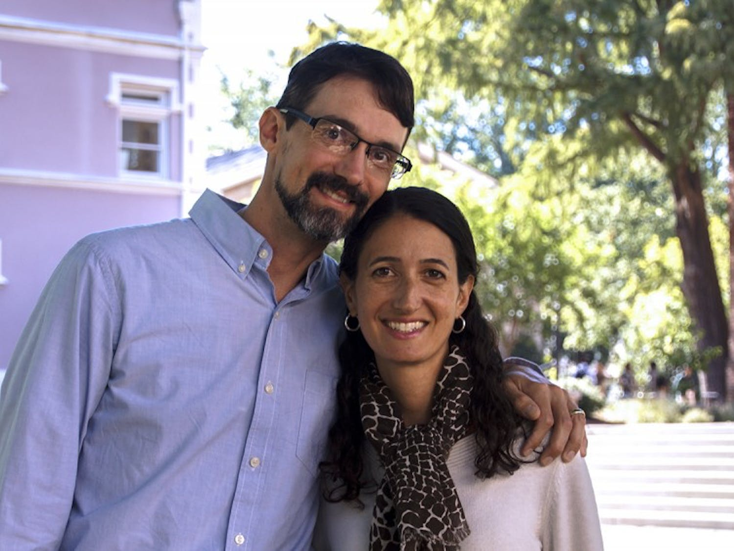 Brian Hogan, a chemistry professor, and Kelly Hogan, a biology professor, pose next to the Old Well. The Hogan's made a video for the 2015 UNC teaching awards.
