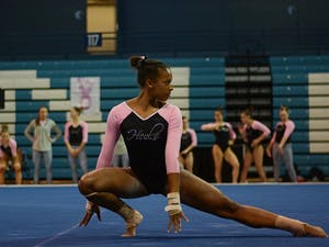 First-year Khazia Hislop performs her floor routine on Friday evening.