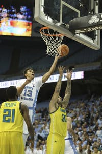 Guard Cameron Johnson takes a layup against UNC-Wilmington in the Disaster Relief Jamboree on Nov. 5 in the Smith Center.