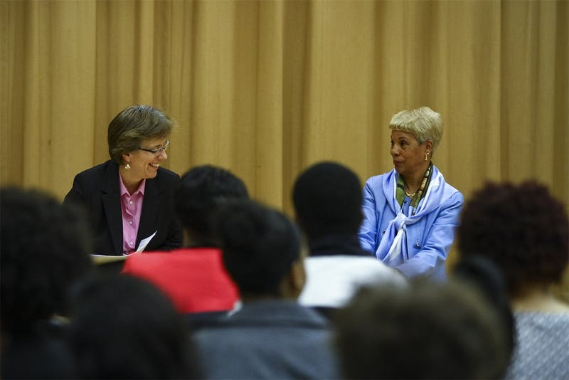 Carrboro mayor Lydia LaBelle and Edith Parker, a Carolina alumnus, speak on a panel of minority women leaders in the Stone Center on Wednesday evening.
