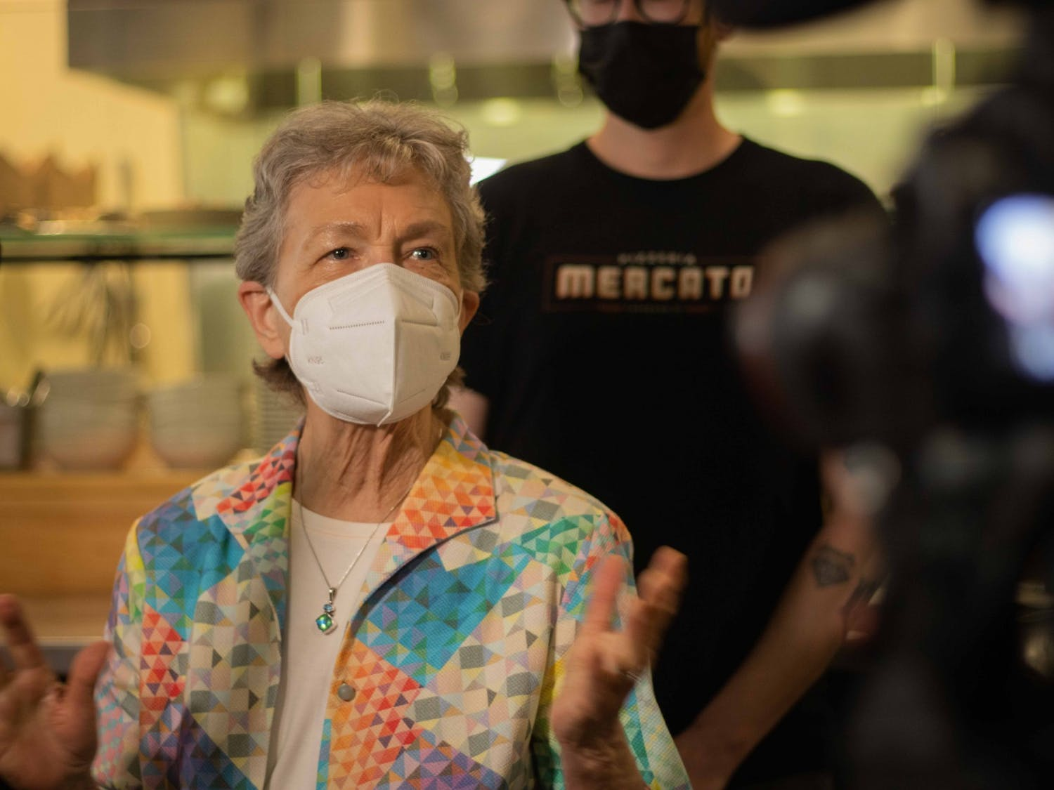Rep. Verla Insko speaks Thursday at Pizzeria Mercato in Carrboro, which recently implemented a vaccination requirement to dine there.