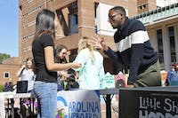 Roderick Gladney (right), founder and chairman of Carolina Cupboard, an organization that provides free food to the UNC campus community, helps recruit new members in the Pit in October 2014. DTH file photo by Johanna Ferebee.