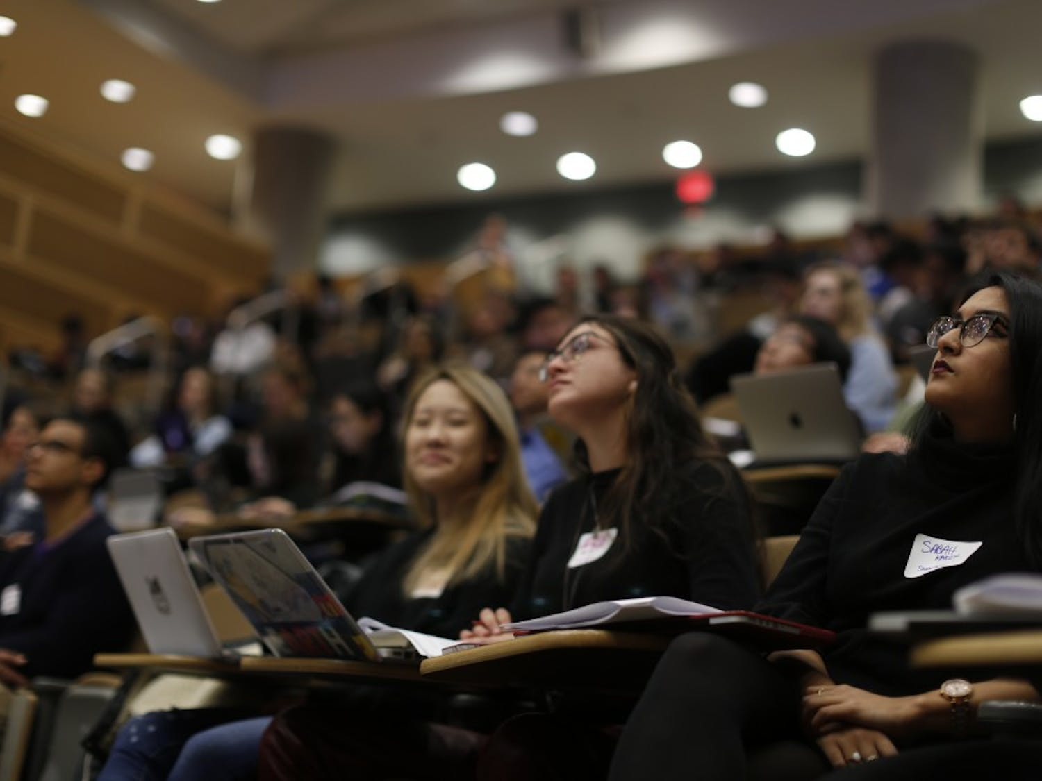 Sabah Kadir (right) looks on to Phaedra Boinodiris' keynote lecture on the future of artificial intelligence in UNC's Makathon on Sunday, Feb. 10, 2019 in Murray Hall.