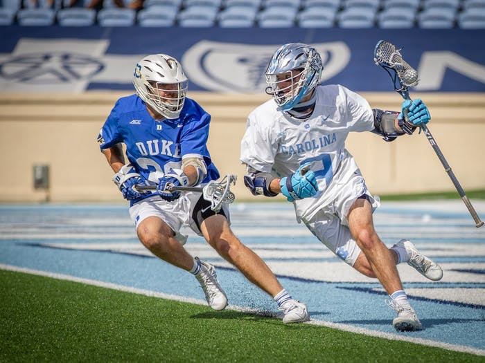 UNC junior attackman Jacob Kelly (9) sprints to the goal during the Tar Heels' 15-12 victory against Duke on Sunday, May 2. With the victory, UNC and Duke share the 2021 ACC regular season title.