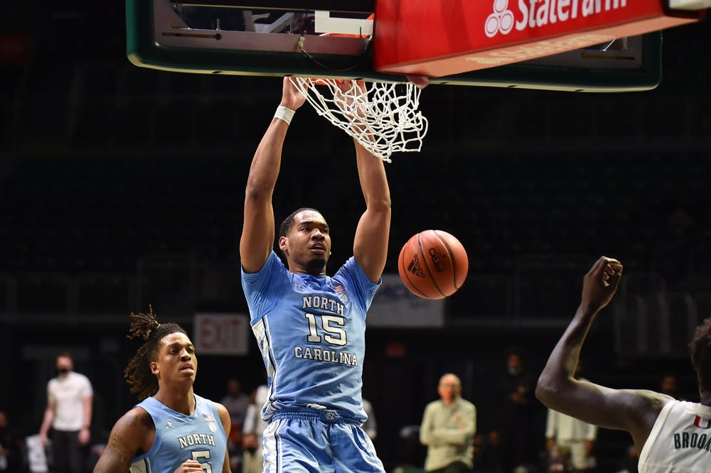 UNC senior forward Garrison Brooks (15) dunks the ball during a game against Miami on Tuesday, Jan. 5, 2021. UNC beat Miami 67-65. Photo courtesy of Maggie Boulton and Jeffrey Ridley.