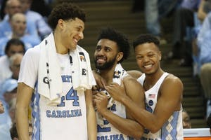 North Carolina players Justin Jackson (44), Joel Berry (2) and Nate Britt (0) are all smiles after the men's basketball team's victory over Duke on Saturday night.