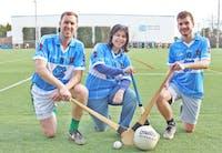 Sarah Holstein, Dara Ó hAnnaidh and Samuel Haddad practice Gaelic Football and Hurling Monday as part of The Irish Sports and Culture Club.