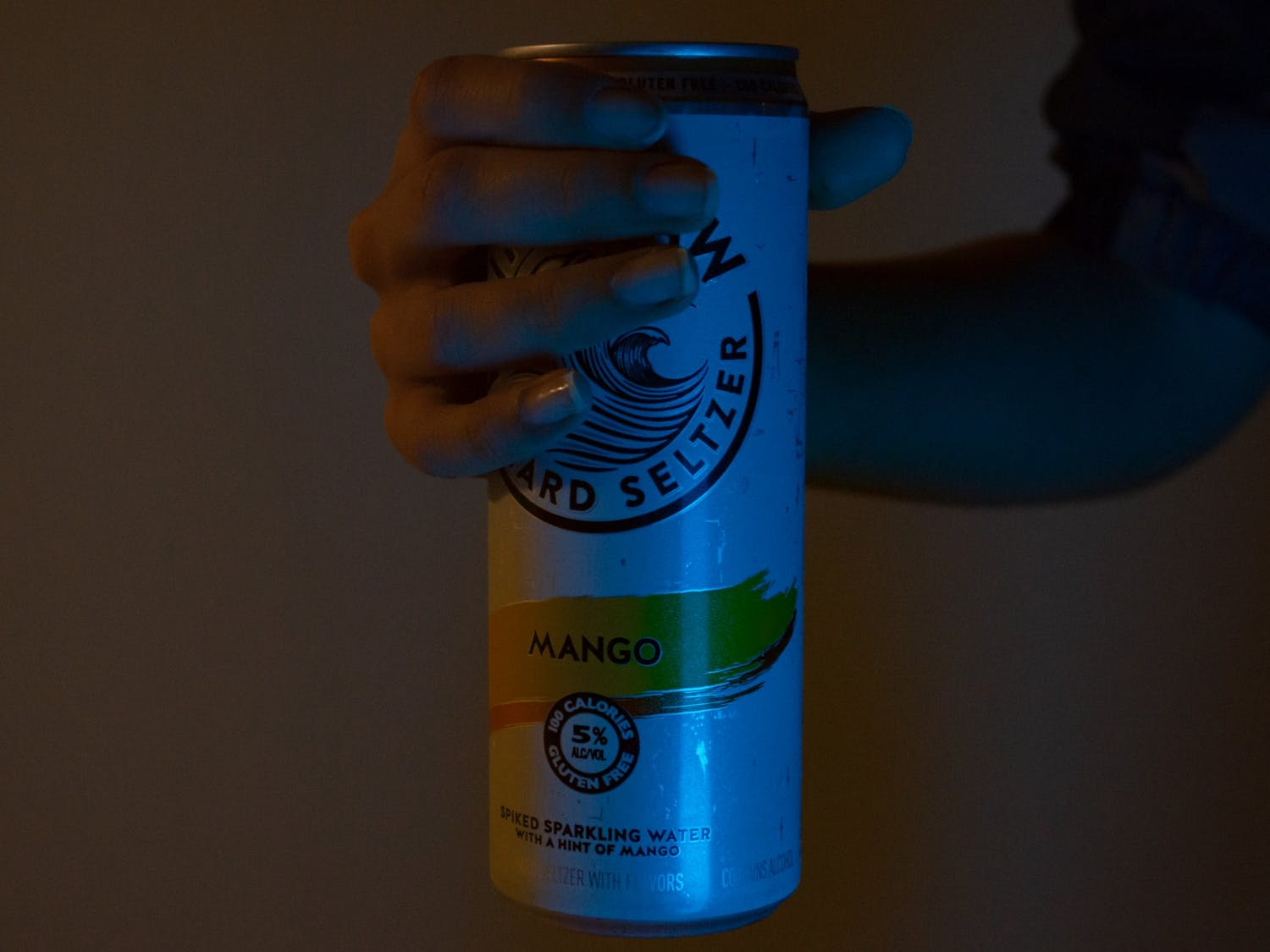 DTH Photo Illustration. Someone holds a can of hard seltzer which contains 5% alcohol.