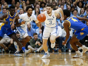UNC junior guard Andrew Platek (3) runs the ball upcourt during a game against Pitt in the Dean Smith Center on Wednesday, Jan. 8, 2020. The Tar Heels lost to the Panthers 65-73.