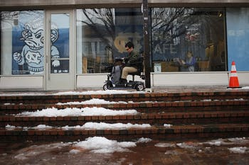 "Logan Gin, a senior biology and political science major, said ""Navigating UNC can be difficult in normal conditions, let alone in the snow."""