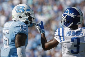 North Carolina safety Donnie Miles (15) and Duke wide receiver T.J. Rahming (3) jaw during the game on Saturday, Sept, 23. 2017. UNC lost 27-17.