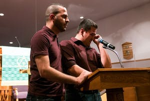 Felipe Molina Mendoza (right) speaks at a vigil with his boyfriend Francisco Vargas Guadalupe. Molina Mendoza was allowed to remain in the U.S. after a hearing Tuesday.