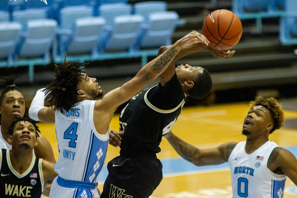 UNC freshman guard RJ Davis (4) defends against Wake Forest junior guard Daivien Williamson (4) in the Dean Smith Center Jan. 20, 2021. The Tar Heels beat the Demon Deacons 80-73.