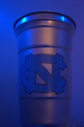Aluminum cups will be available for $5 at select sporting events to promote sustainability.